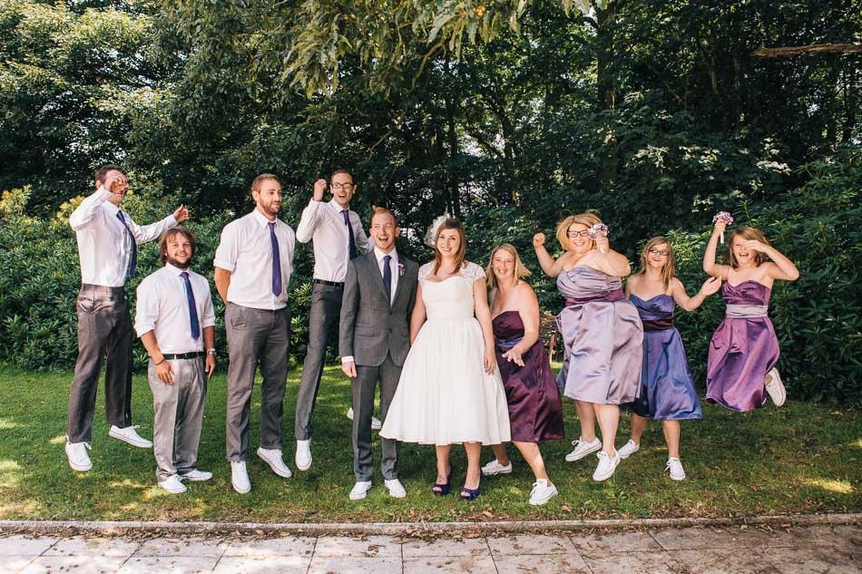 Group Shot of Bridal Party Jumping