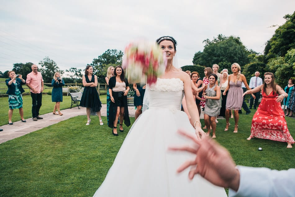 Bride throwing bouquet at Hilltop Country House