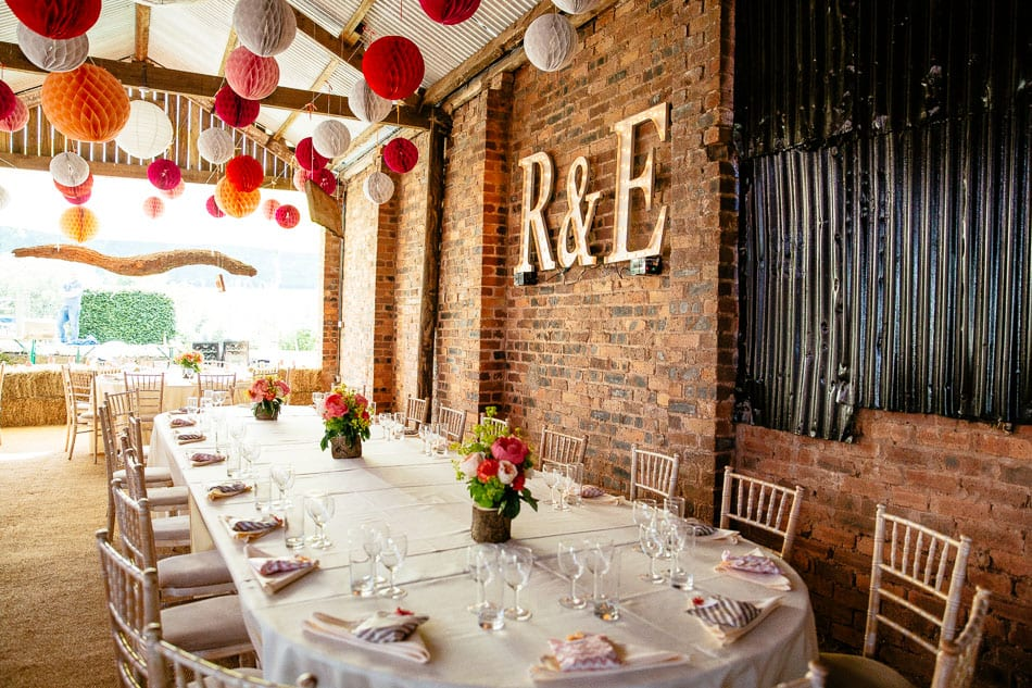 Light up letters and pom poms wedding reception