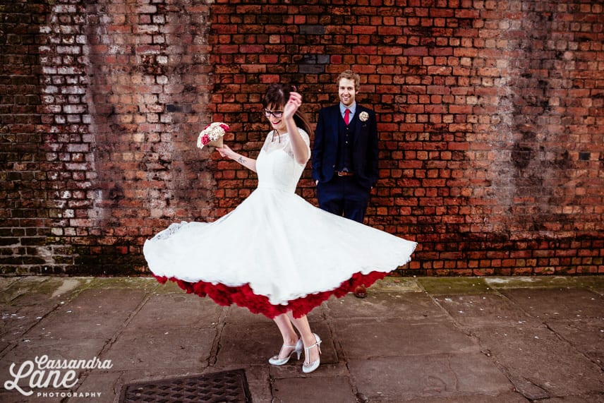 1950s style wedding dress with red petticoat