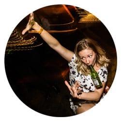 woman drinking beer and dancing at a wedding at Victoria Warehouse