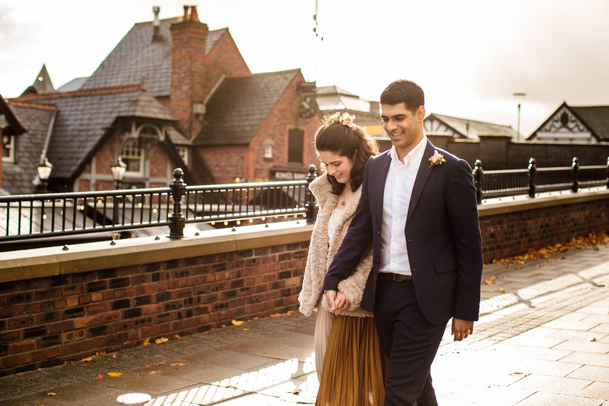 Couple walking on Sale Waterside