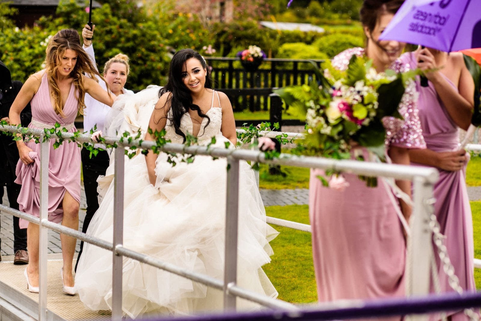 Bride and bridesmaids boarding boat on Loch Ness