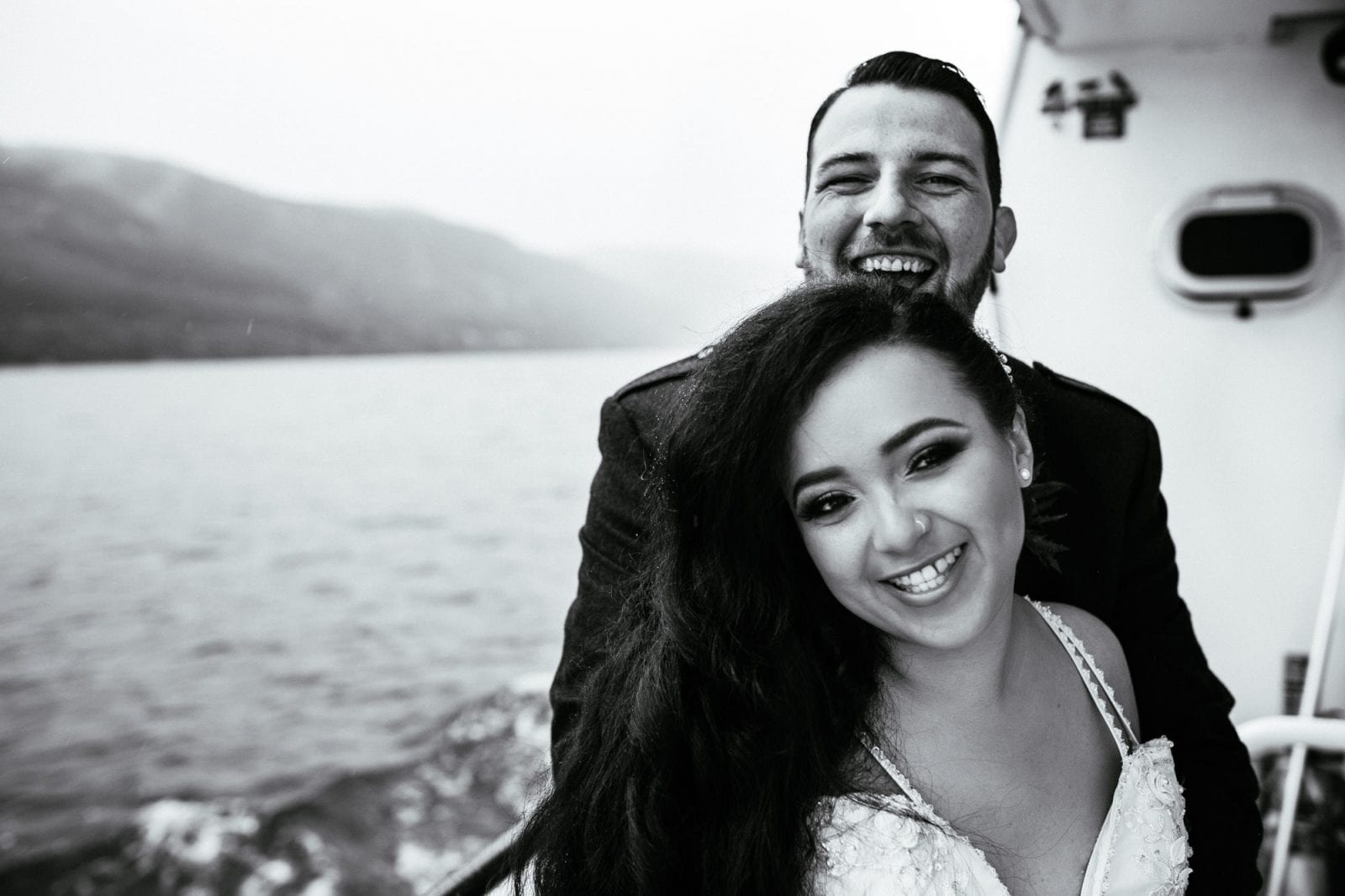 Bride and groom portrait on a boat on Loch Ness