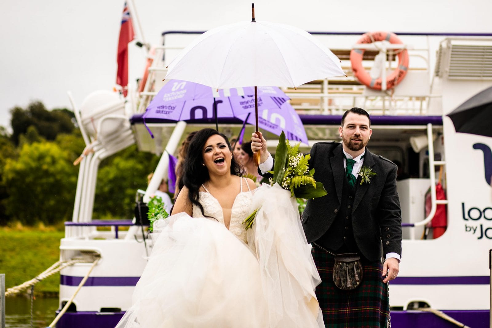 Bride and groom walking off boat on Loch Ness