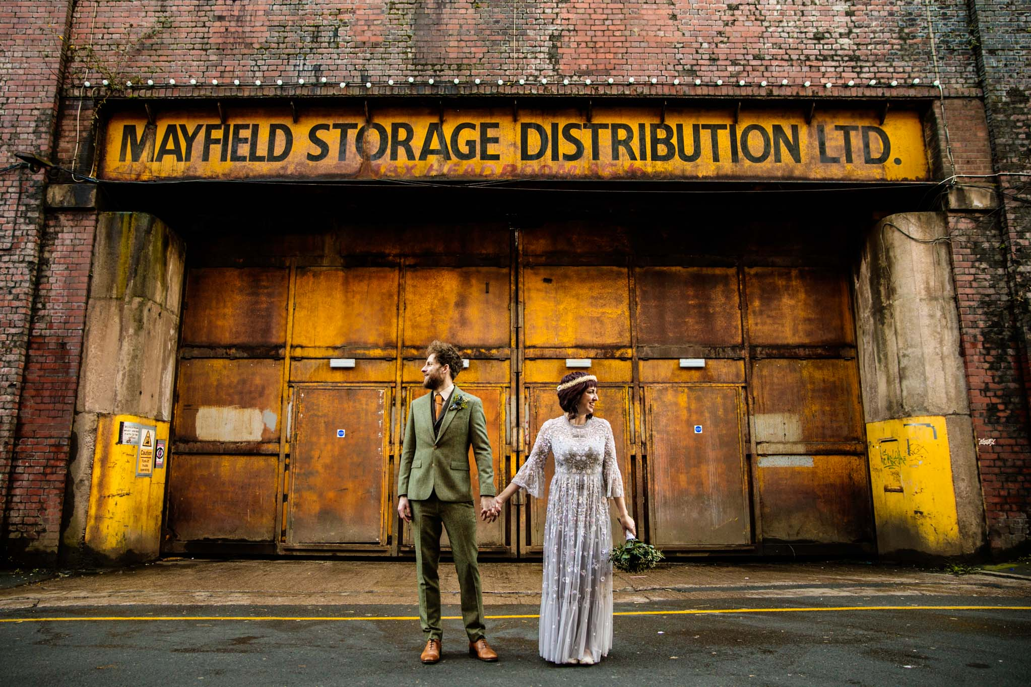 Alternative Bride and groom in urban area of Manchester