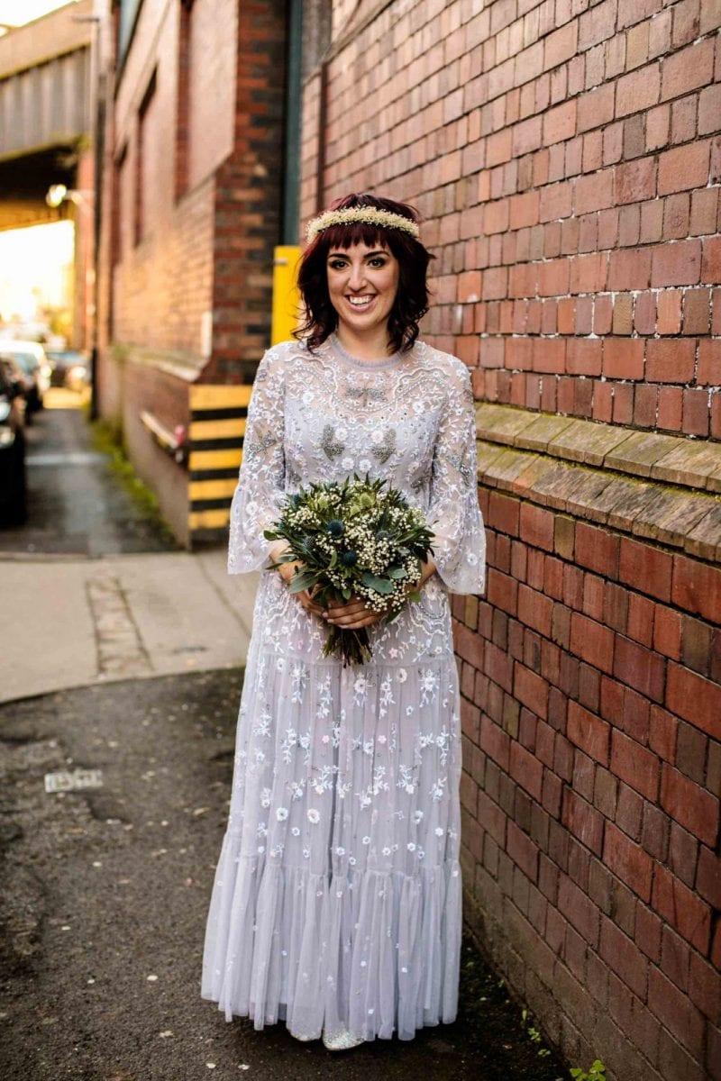 Alternative bride in Needle & Thread wedding dress