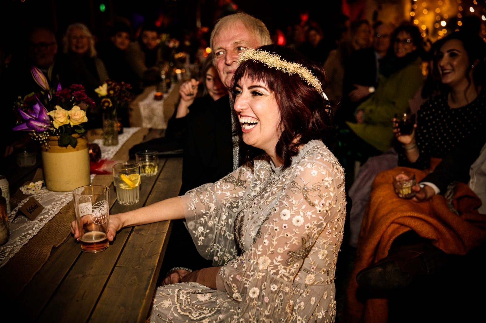 Alternative bride laughing during wedding speech