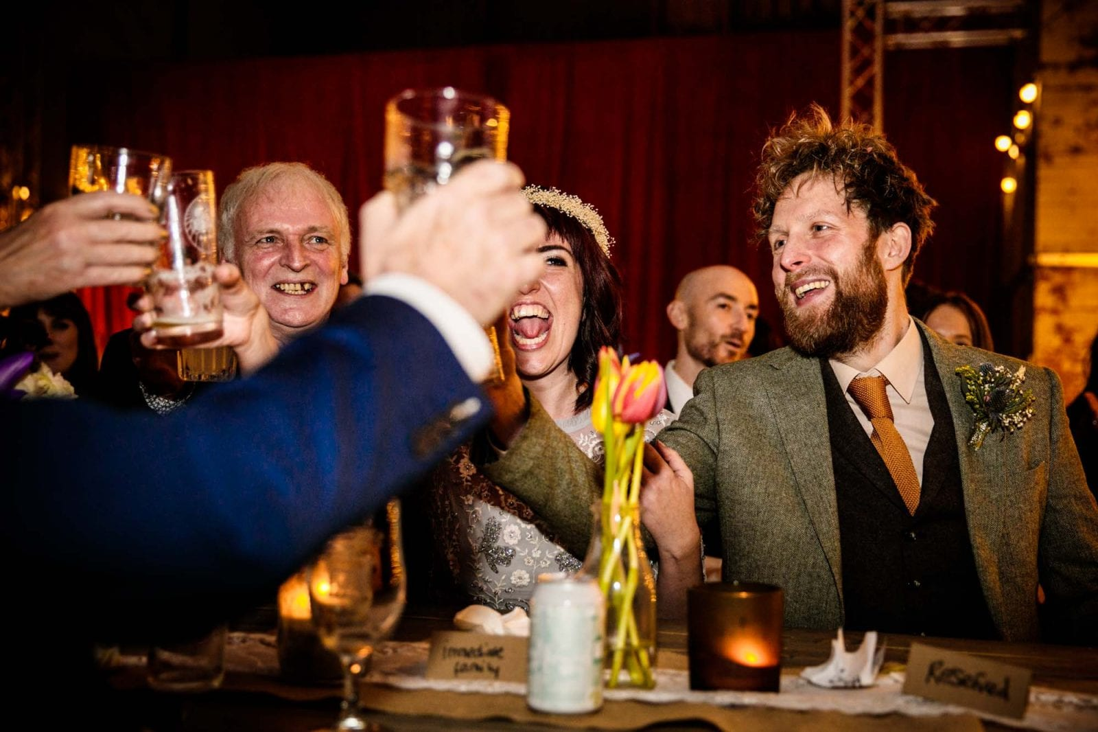wedding guests toasting during speeches