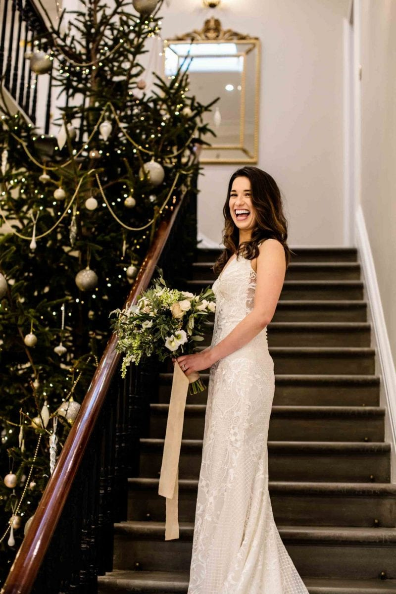 Bride on the stairs at St Tewdrics House