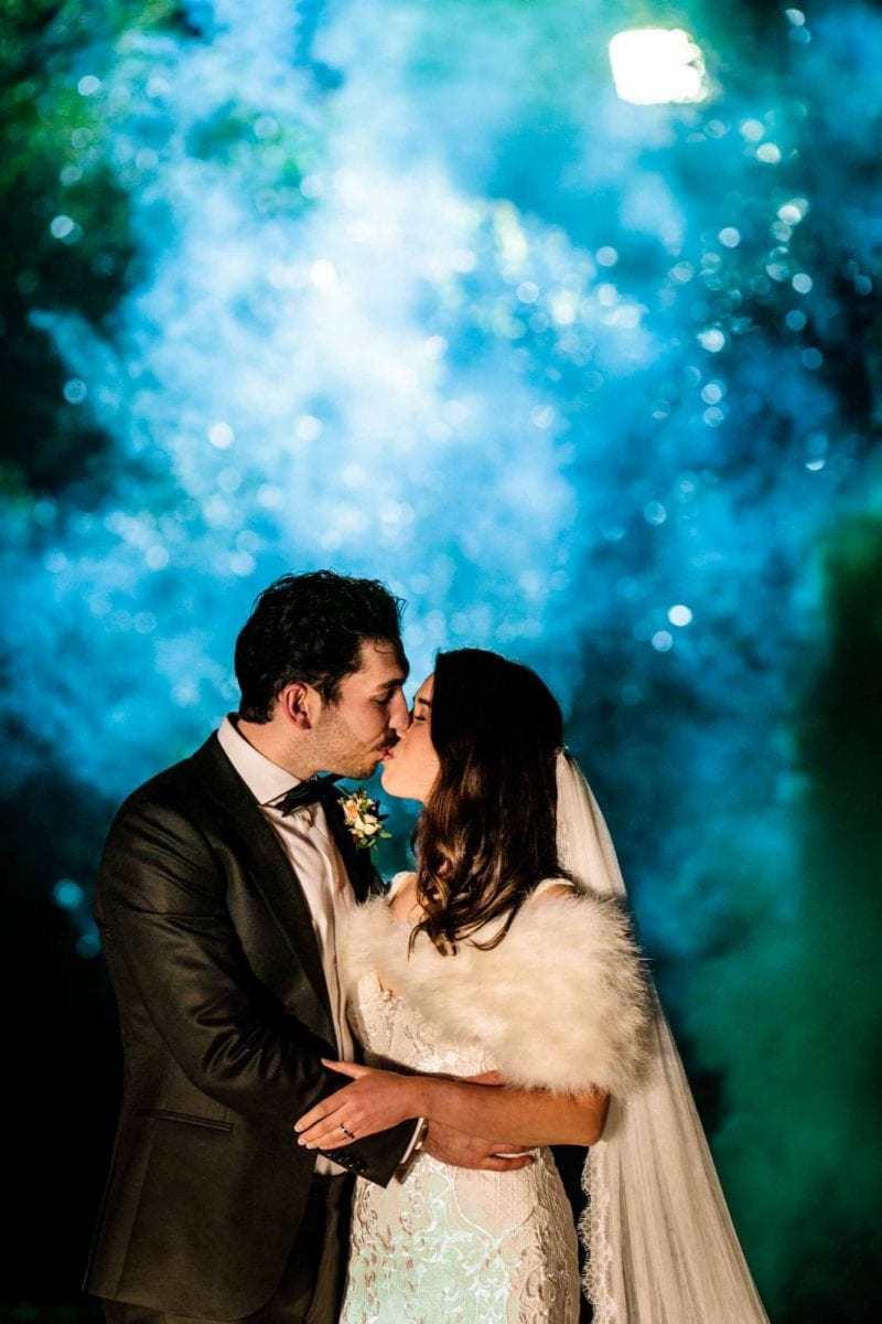 Colourful photo of bride and groom at St Tewdrics House