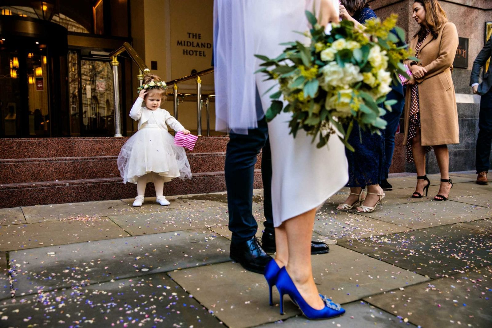 Flower girl tipping out confetti