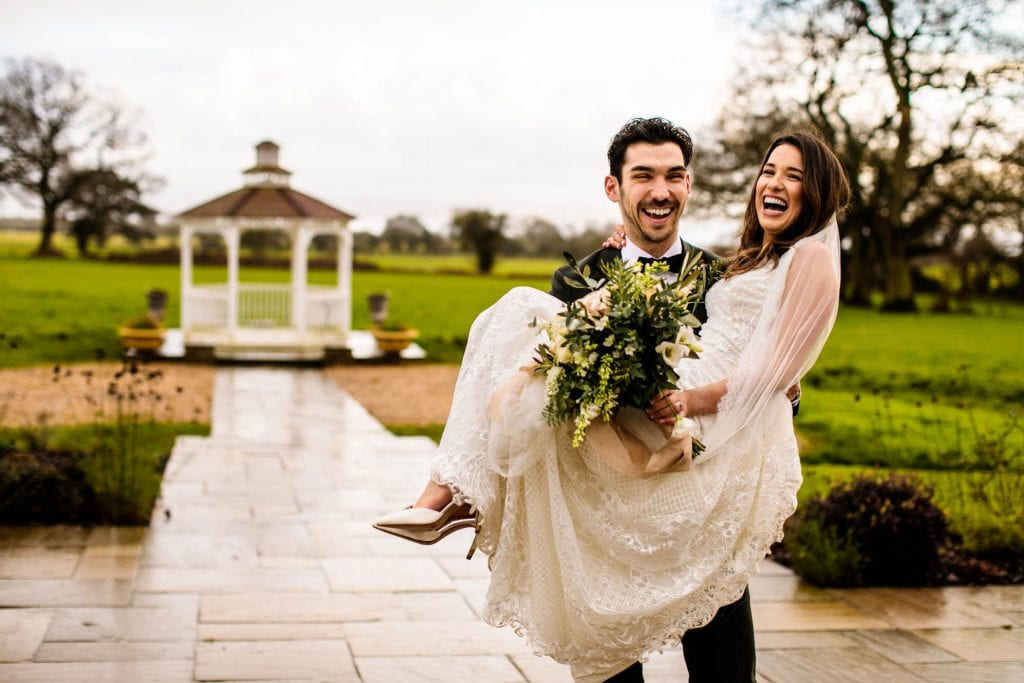 Groom lifting bride at St Tewdrics House
