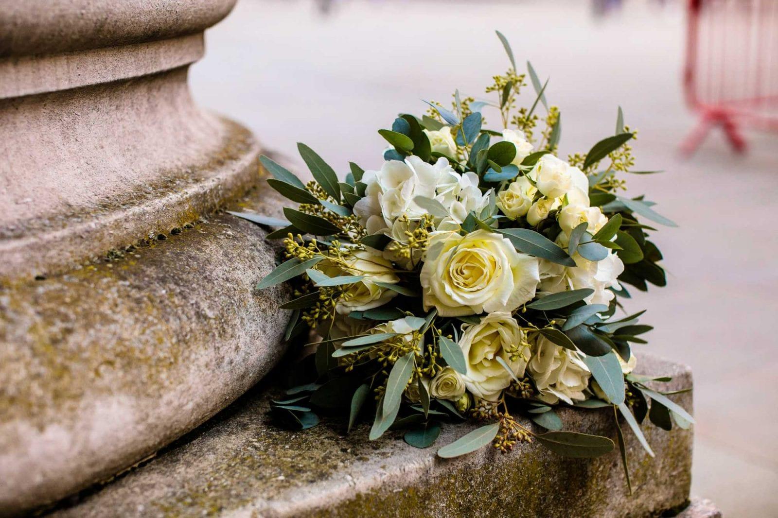 Wedding bouquet of white roses and euycalyptus