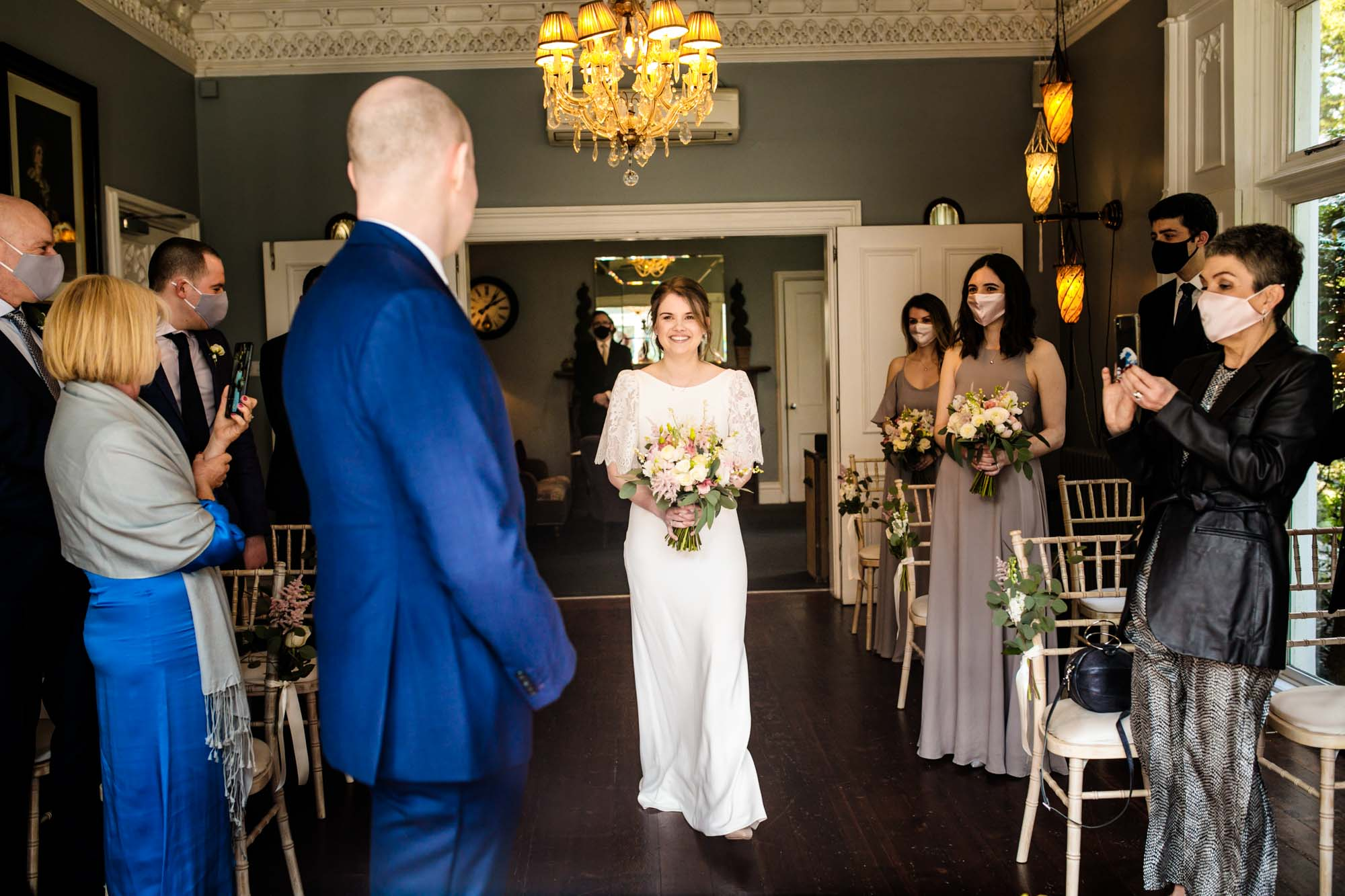 Bride walking down the aisle at Didsbury House Hotel
