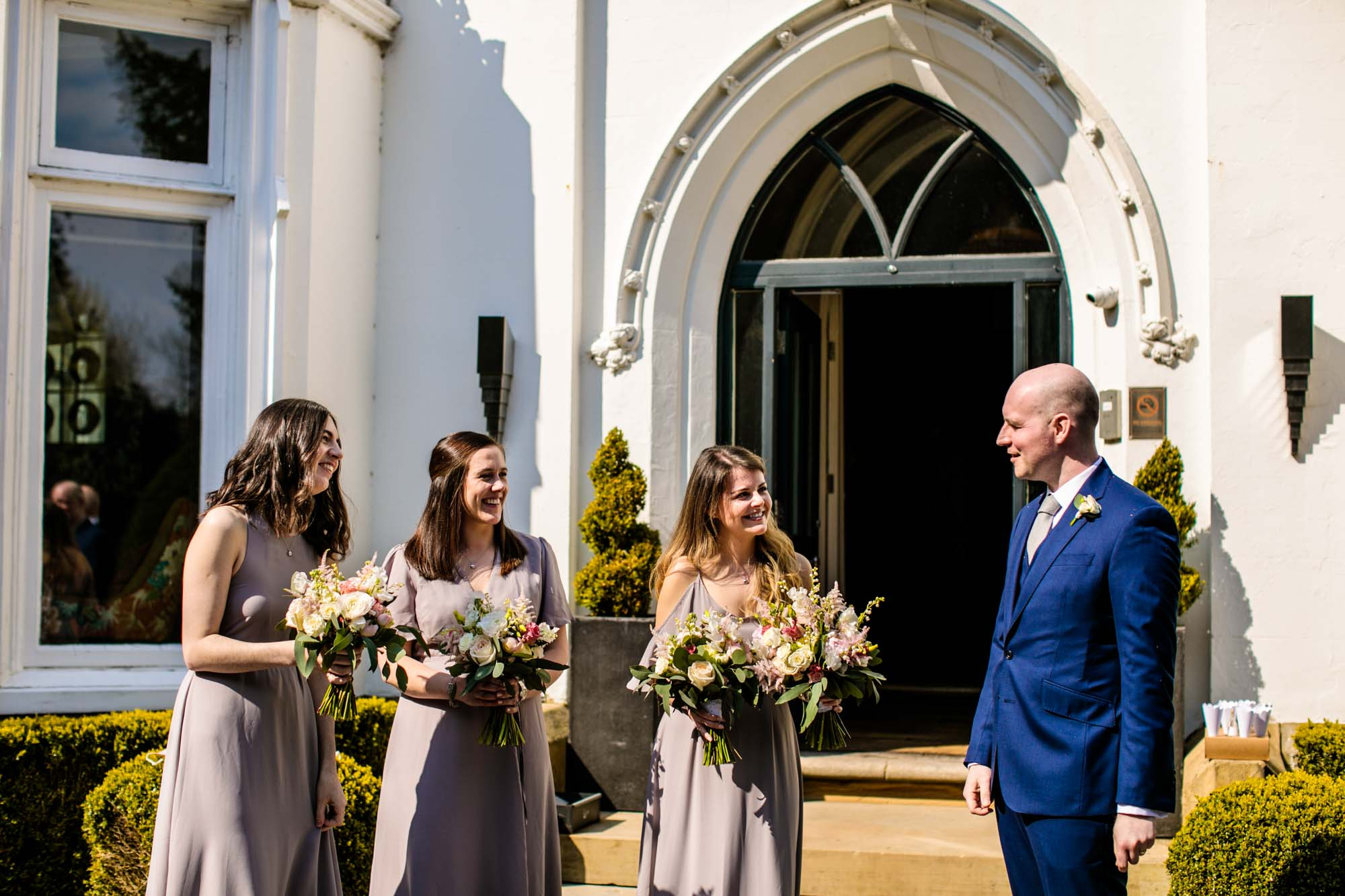 Wedding guests outside Didsbury House Hotel