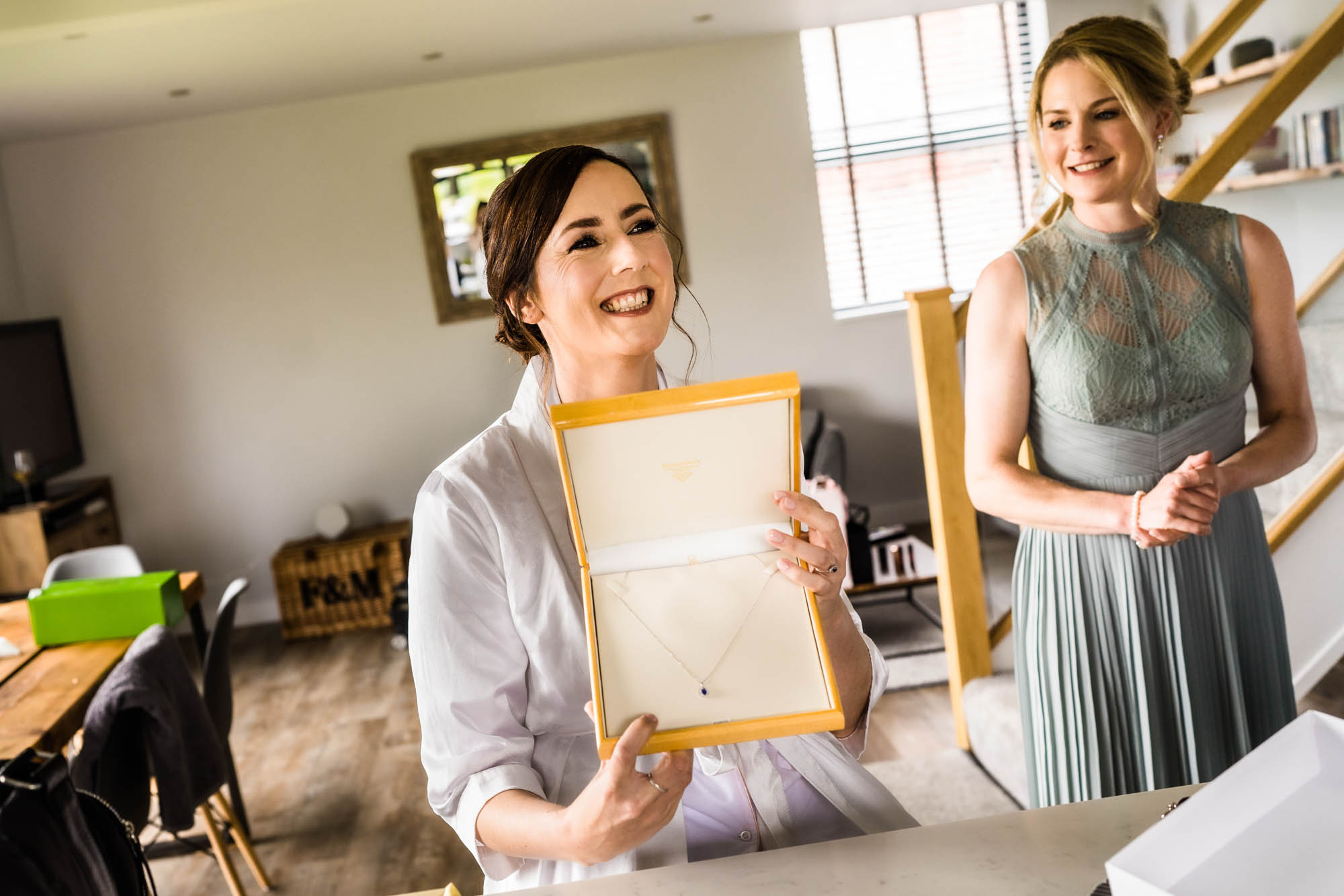 Bride smiling as she opens present